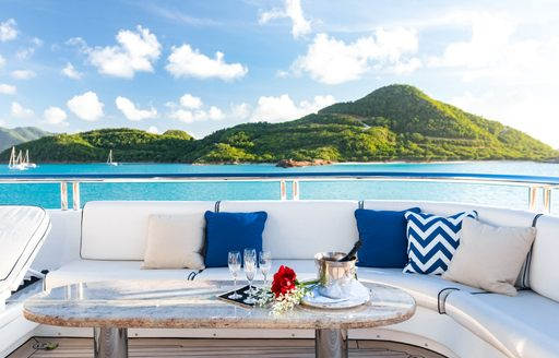 al fresco seating on board motor yacht TITANIA with champagne flutes