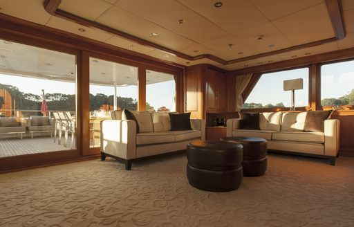 sofas form a seating area in a salon aboard charter yacht RELENTLESS