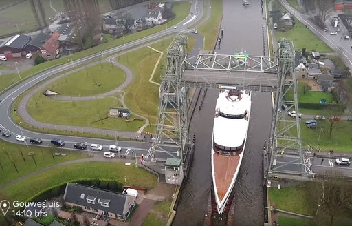 Drone shot of megayacht Lady S on the canals in Holland
