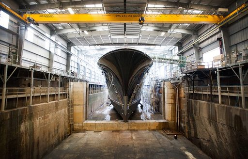 Superyacht AQUILA in the shed at the Pendennis shipyard in Falmouth, England