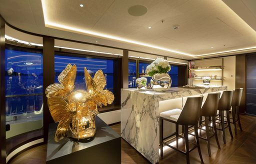 lunasea yacht statues and marble clad bar