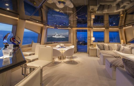 Main salon aboard luxury yacht INVISION with star panelled ceiling