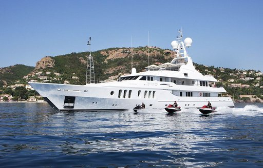 superyacht Talisman Maiton at anchor as charterers take out the jet skis