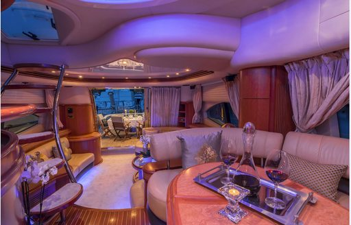 Main salon of M/Y ALMAZ, with blue lighting and seating areas