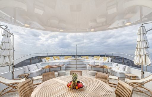 Alfresco dining arrangement on luxury expedition yacht Baron Trenck