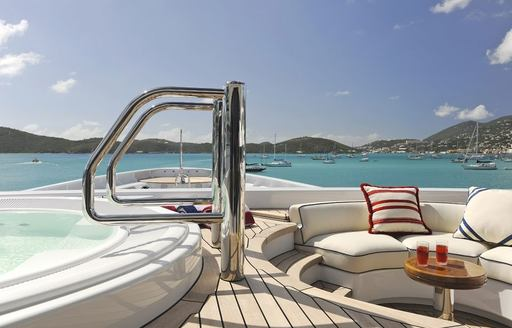 THe private deck attached to the master suite with Jacuzzi and seating
