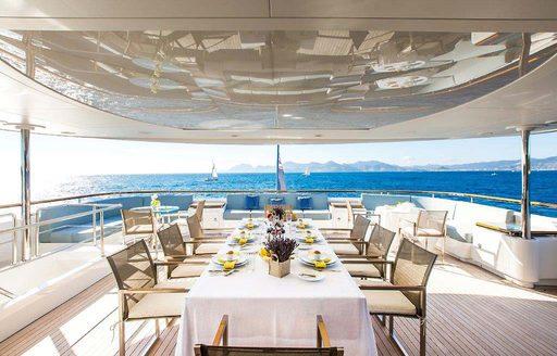 Alfresco dining area on charter yacht VERTIGO
