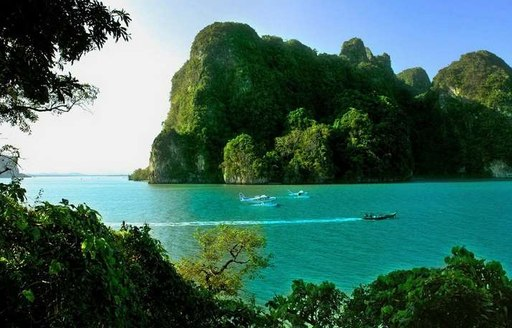 Vessels in the waters surrounding Ao Phang-Nga National Park, Thailand