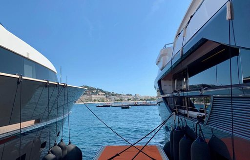 2 yachts alongside each other at Cannes Yachting Festival 2019