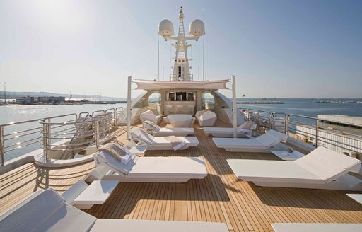 sundeck and lounge chairs on board superyacht light holic