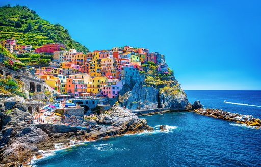 Beautiful colorful cityscape on the mountains over Mediterranean sea, Europe,