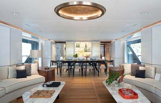 interiors of benetti luxury yacht rebeca, main salon with dining table