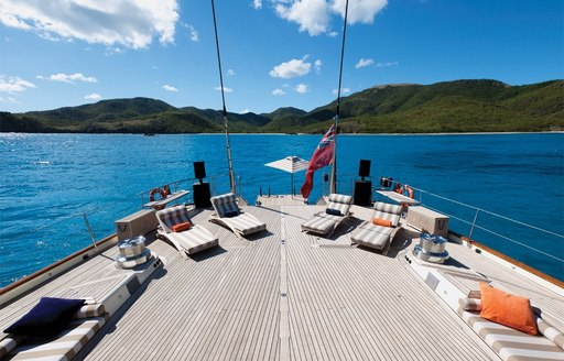 spacious aft deck during the day with sun loungers aboard luxury yacht TIARA