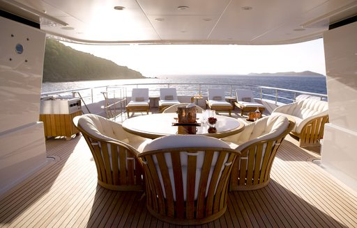 Sun deck of superyacht HARLE with light streaming in