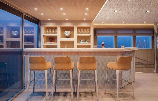 Chairs around bar of sailing yacht Love Story