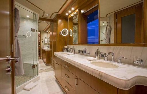 Marble sinks and luxurious bathroom en suite on board motor yacht Far Niente