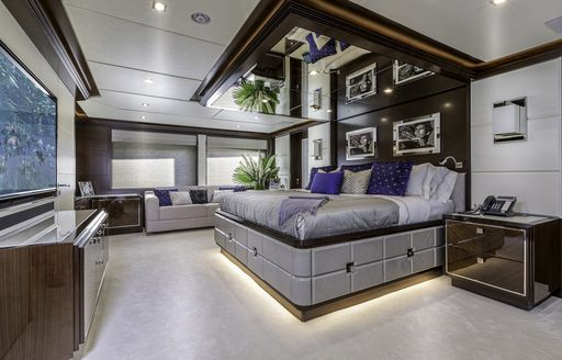 contemporary master suite with rock n roll photography on board luxury yacht 'King Baby'