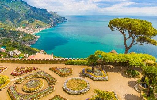 Lovely tree-lined flowery gardens overlooking the sea on the Amalfi Coast