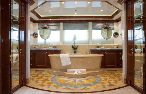 master suite on luxury yacht st david with mosaic tiled floors and grand bathtub