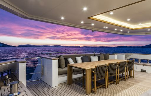 sun  setting over the aft of charter yacht katia