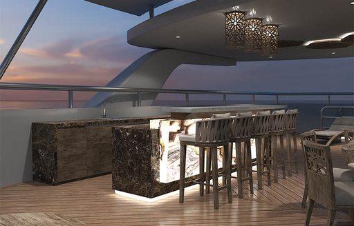 back-lit bar with stools on the sundeck of luxury yacht ELITE