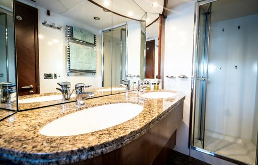 marble his and hers sinks on charter yacht chess
