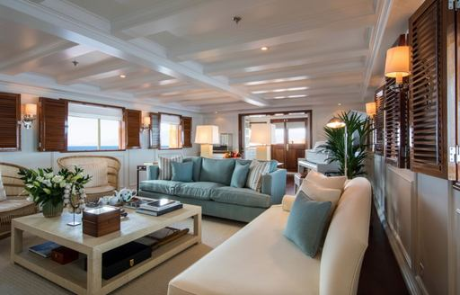 main salon with comfortable sofas on board superyacht Haida 1929