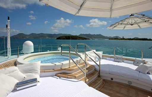 Jacuzzi, sun pads and awnings on sundeck of motor yacht 'Lady Luck'