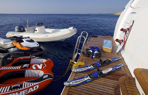 toys and accessories laid out for vacation fun on board charter yacht idylle