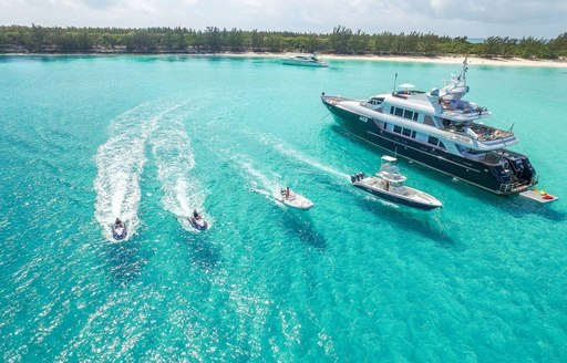 m3 yacht in the bahamas on a tropical vacation, aerial shot with tenders and jet-skis