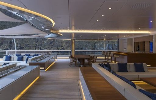 Living areas on the aft deck of luxury charter yacht Flying Fox