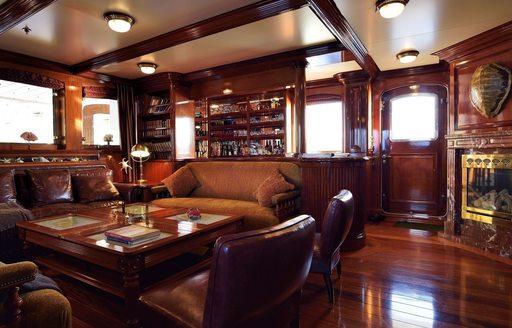 main salon in Cuban mahogany on board expedition yacht STEEL