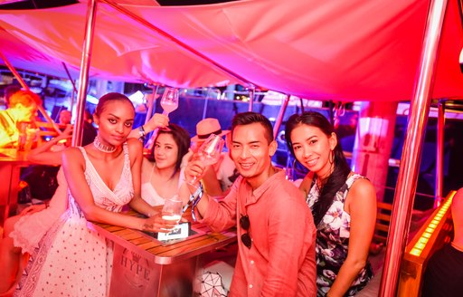 show attendees socialize at the Thailand Yacht Show 2016's closing party aboard luxury yacht HYPE