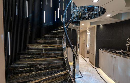 Central staircase with caviar lighting on mimi la sardine