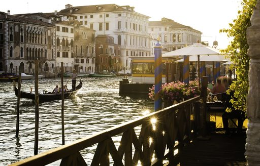 View across the grand canal from a balcony a gondola moves in the centre