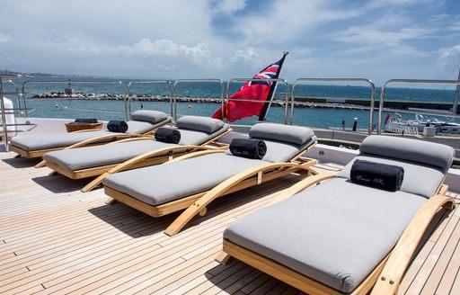 sunloungers line the sundeck of luxury yacht Princess AVK
