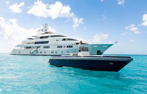 superyacht TITANIA at anchor alongside custom tender