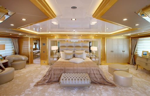 opulent master suite in cream and gold on board motor yacht 'Lady Luck'