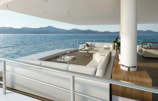 shaded al fresco seating area on board motor yacht SOLO
