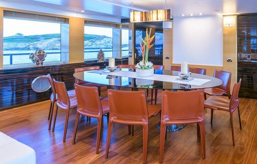 oval-shaped dining table in the main salon of motor yacht Africa I