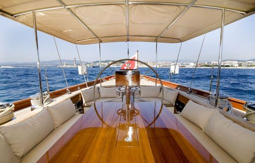Shaded cockpit on board superyacht Aurelius 111 with al fresco dining and seating