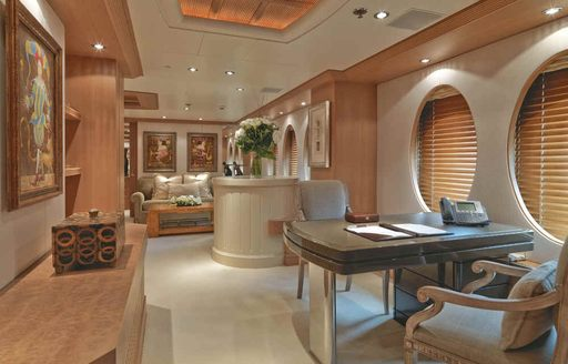 study and seating area on board luxury yacht Deja Too