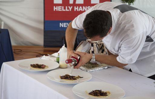 Chef Daniele Messina preparing dishes at the Newport Charter Show 2017
