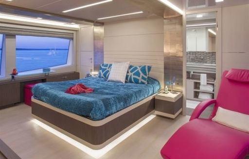 idyllic master suite with blue linen aboard superyacht Alandrea