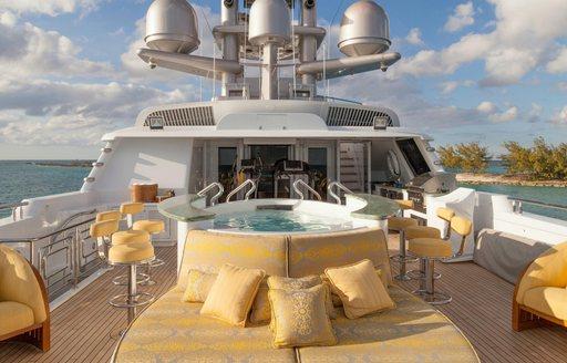 sunpads and Jacuzzi with swim-up bar on the sundeck of luxury yacht My Seanna
