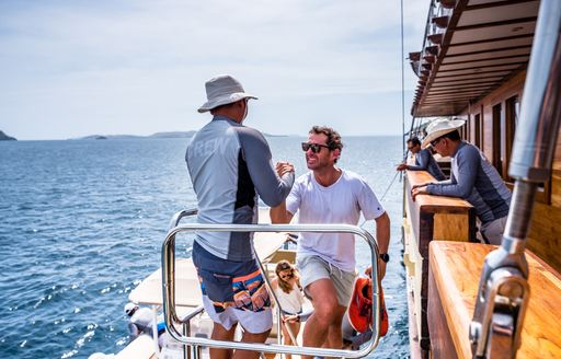 LAMIMA yacht being boarded by charter guests