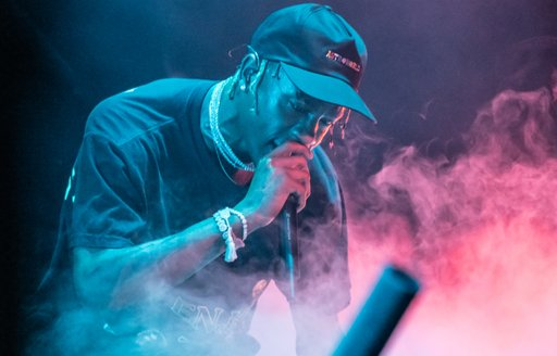rapper Travis Scott performing in front of a large audience on the main stage of Abu Dhabi Grand Prix 2019 after the first day of practise races