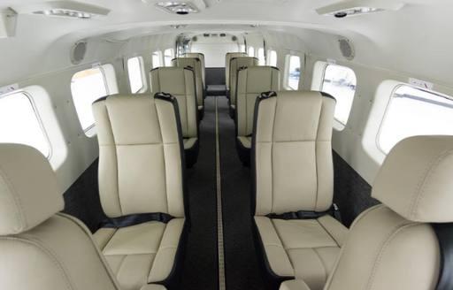 private plane interior, with white leather seats