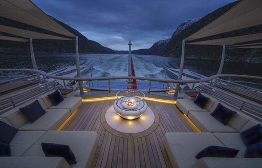 Seating area on charter yacht Flying Fox at night