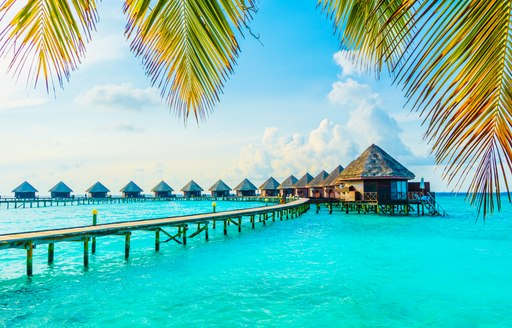 Blue sea in the Maldives, bungalows above the water